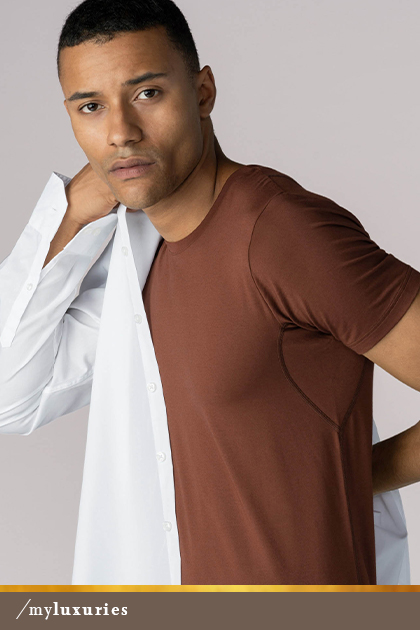 Man wears a half-untucked white shirt and crew neck shirt in the colour Medium Skin from the Business Class series by mey®