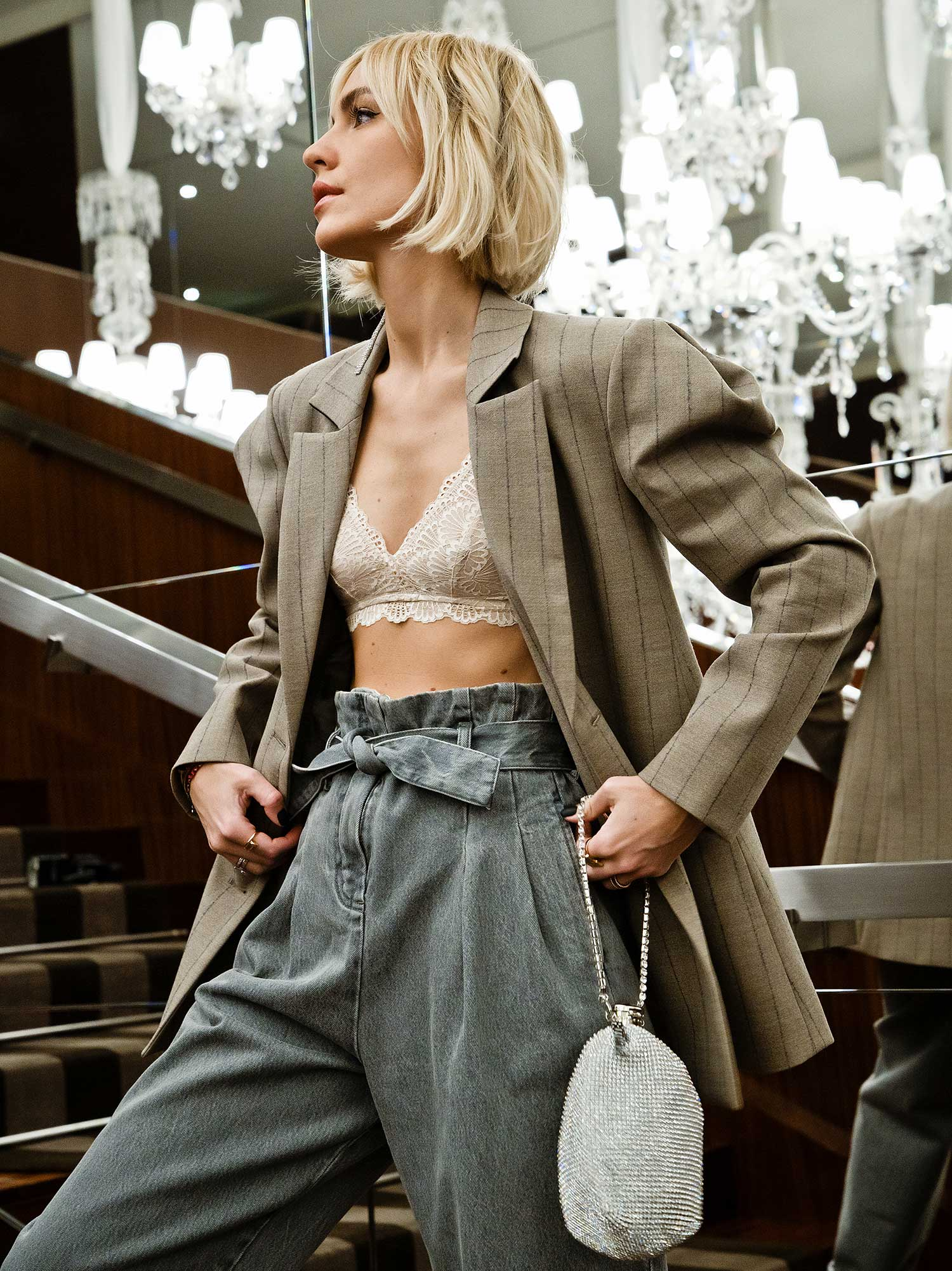Viktoria Rader at Paris Fashion Week with Mey triangle bra in color New Pearl combined with oversize blazer and slouchy denim.   mey®