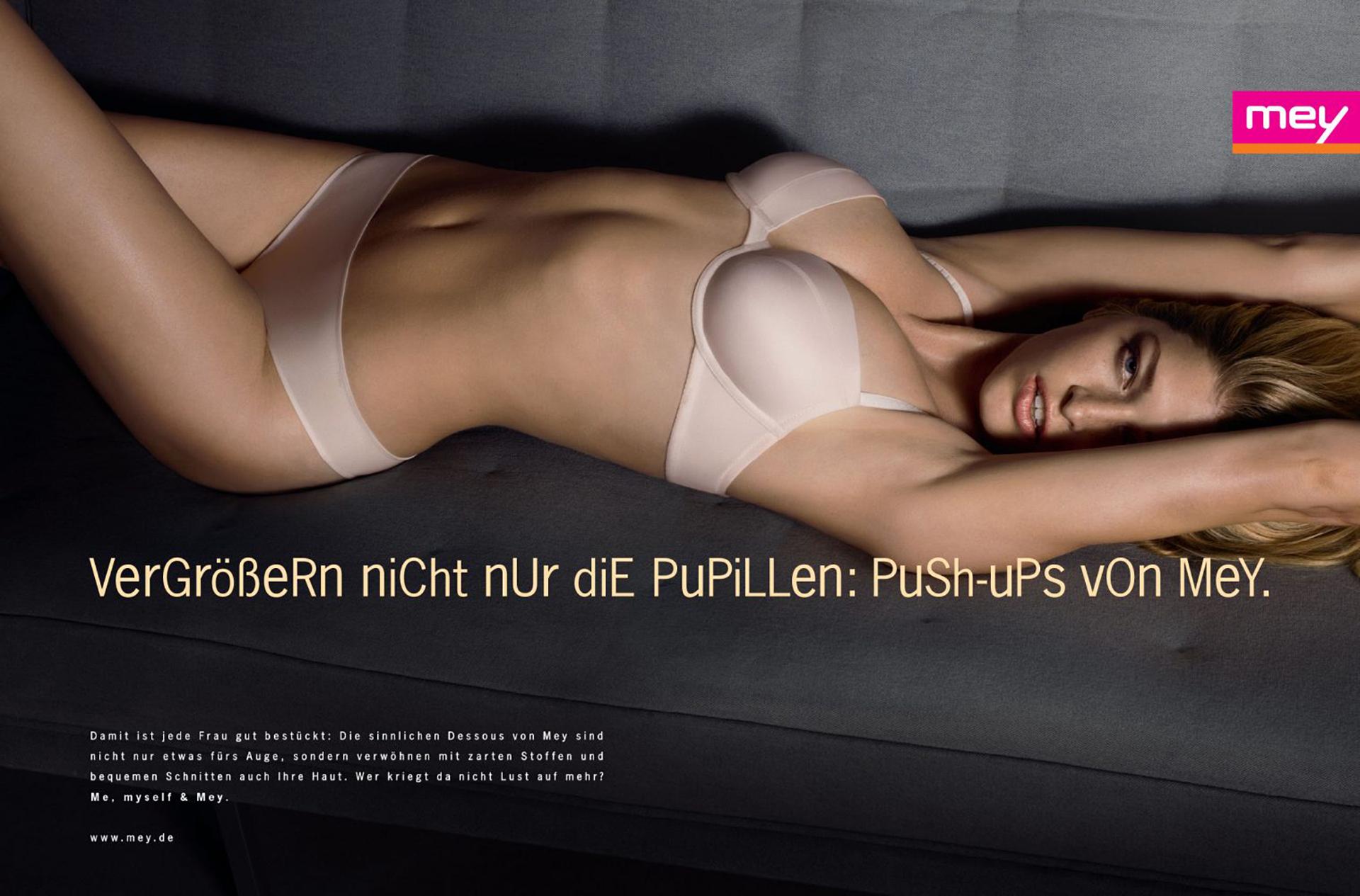 """mey® Werbeanzeige für Push-Up BHs mit dem Slogan """"Vergrößert nicht nur die Pupillen: Push-Ups von Mey."""""""